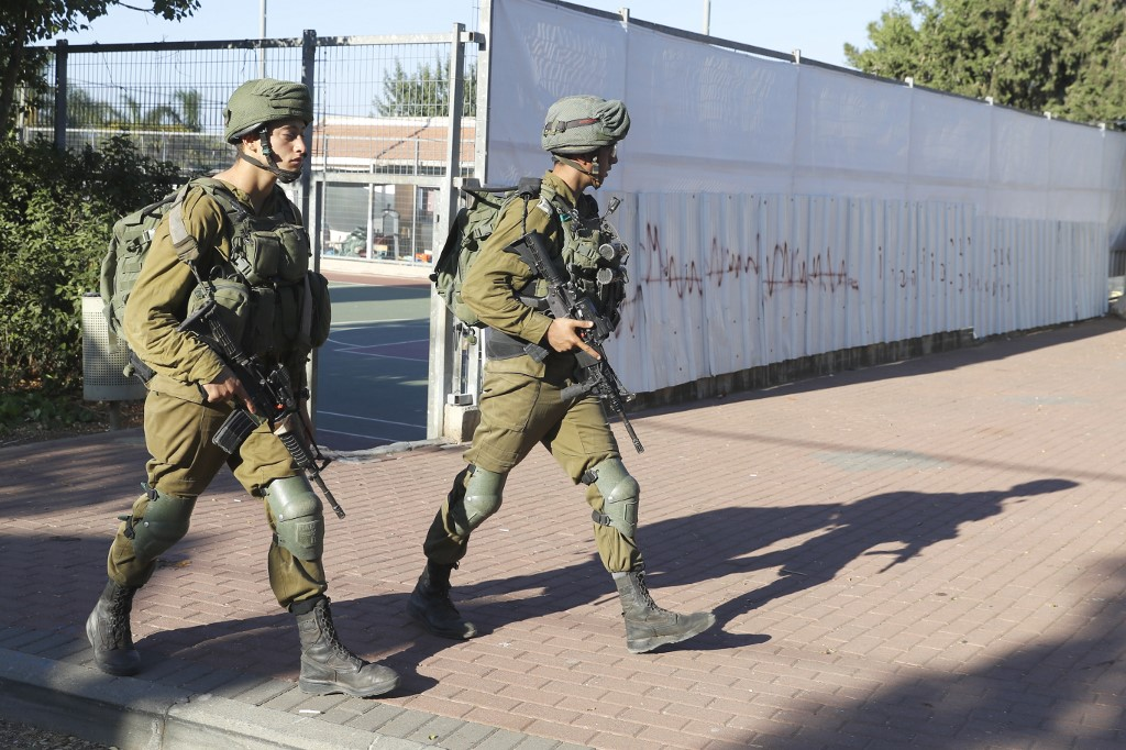 Israeli soldiers patrol in the northern Israel-Lebanon border area on 2 September (AFP)