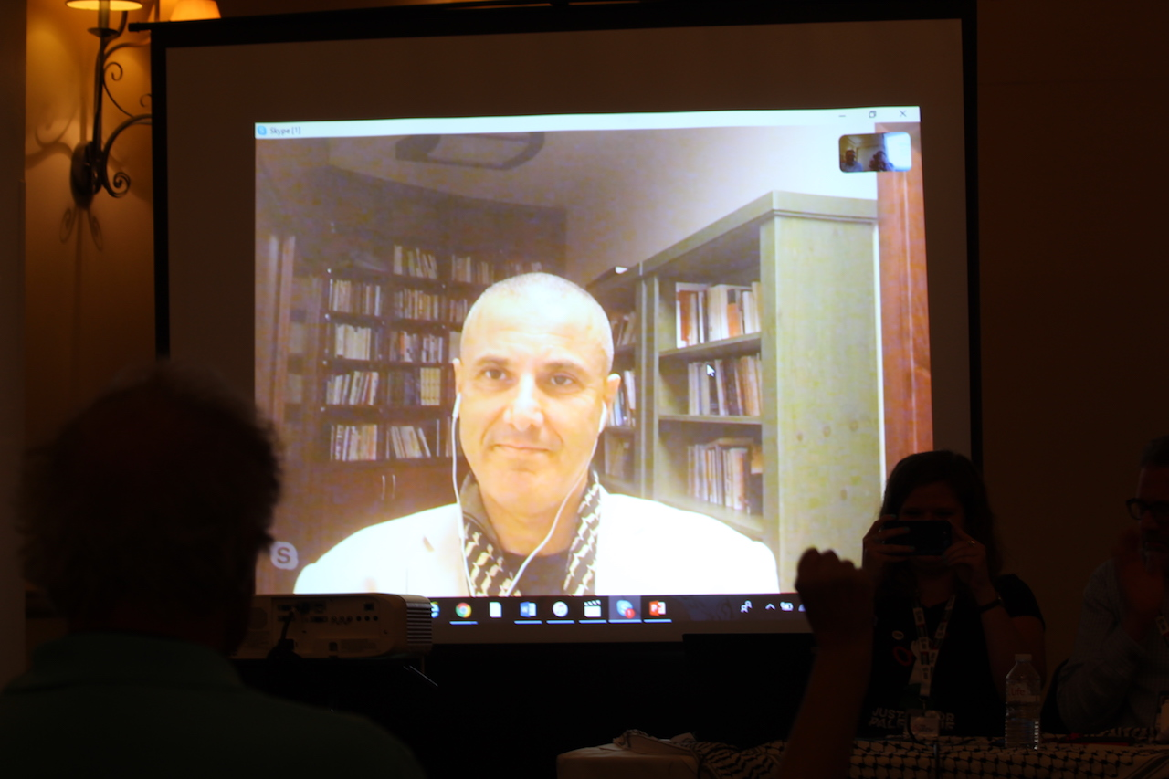 Omar Barghouti speaks at the Labour Party conference via Skype (Alex MacDonald)