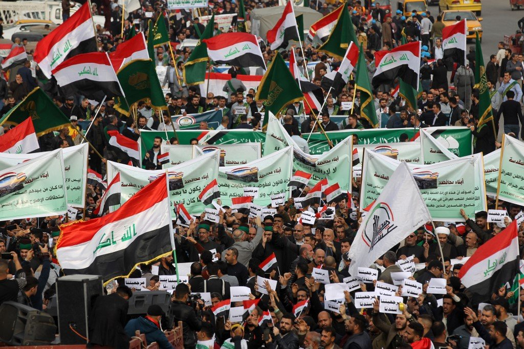 Iraqis protest in Baghdad's Tahrir Square on 6 December (AFP)