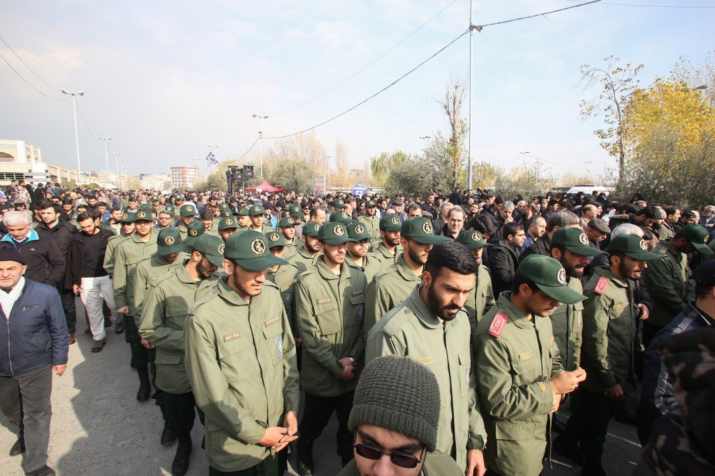 IRGC members protest in Tehran on 3 January over the US killing of Soleimani (AFP)