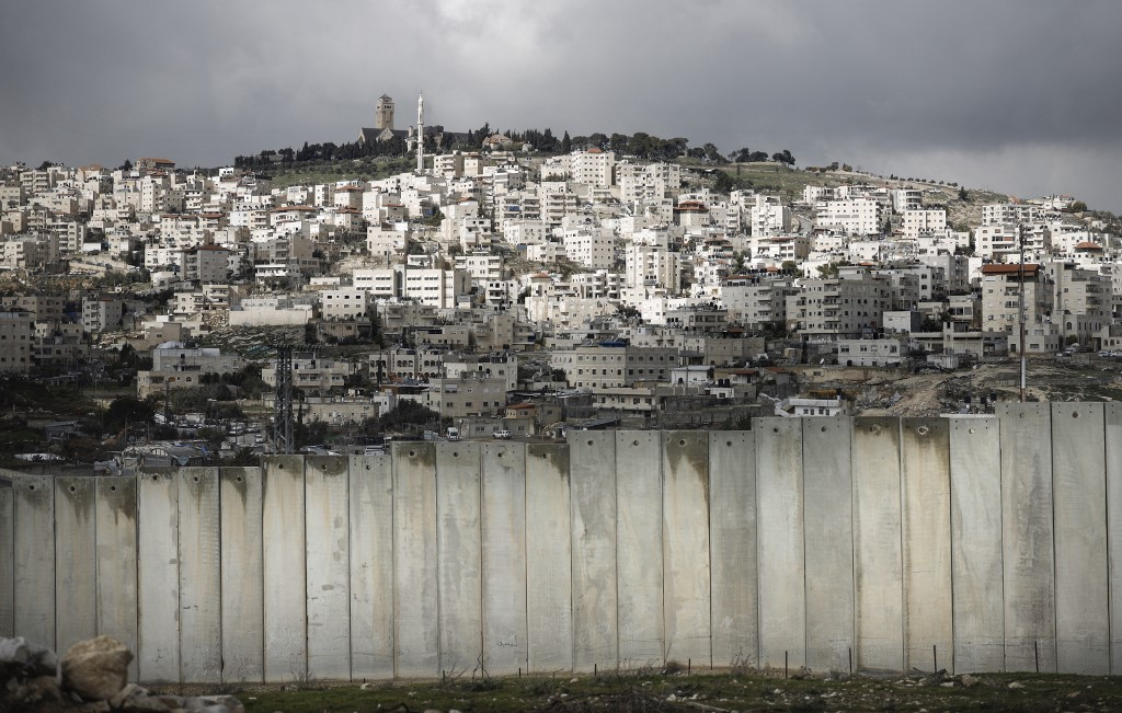 Israel's separation wall is pictured on 17 January (AFP)