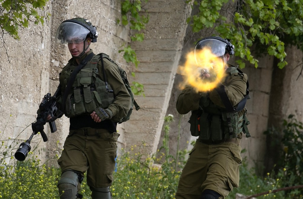 Israeli forces target Palestinian demonstrators in the occupied West Bank on 17 April (AFP)