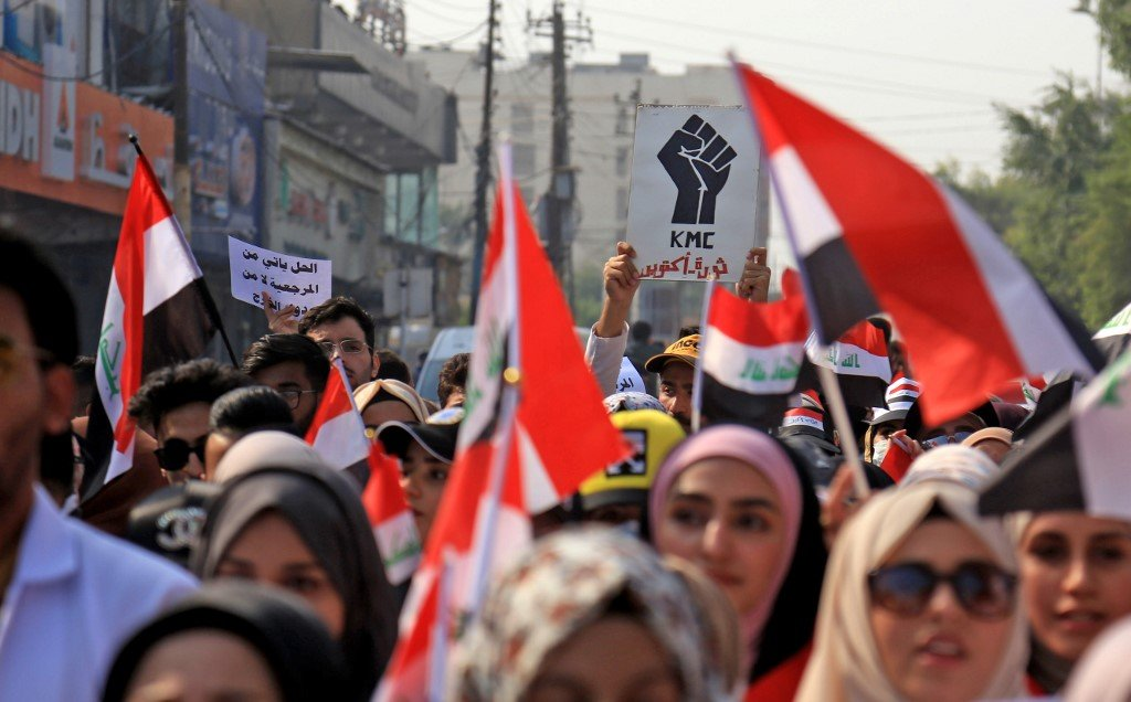 Iraqis take part in an anti-government protest in Karbala on 12 November (AFP)
