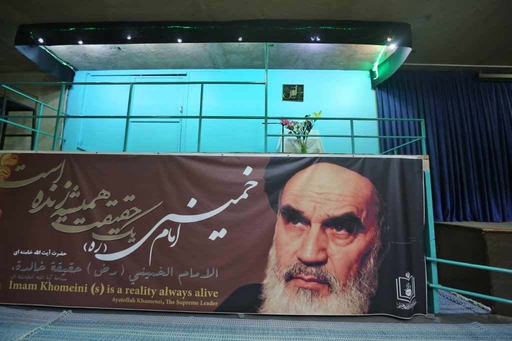 Former Iranian Supreme Leader Ayatollah Khomeini's image appears on a banner in Tehran in May 2019 (AFP)