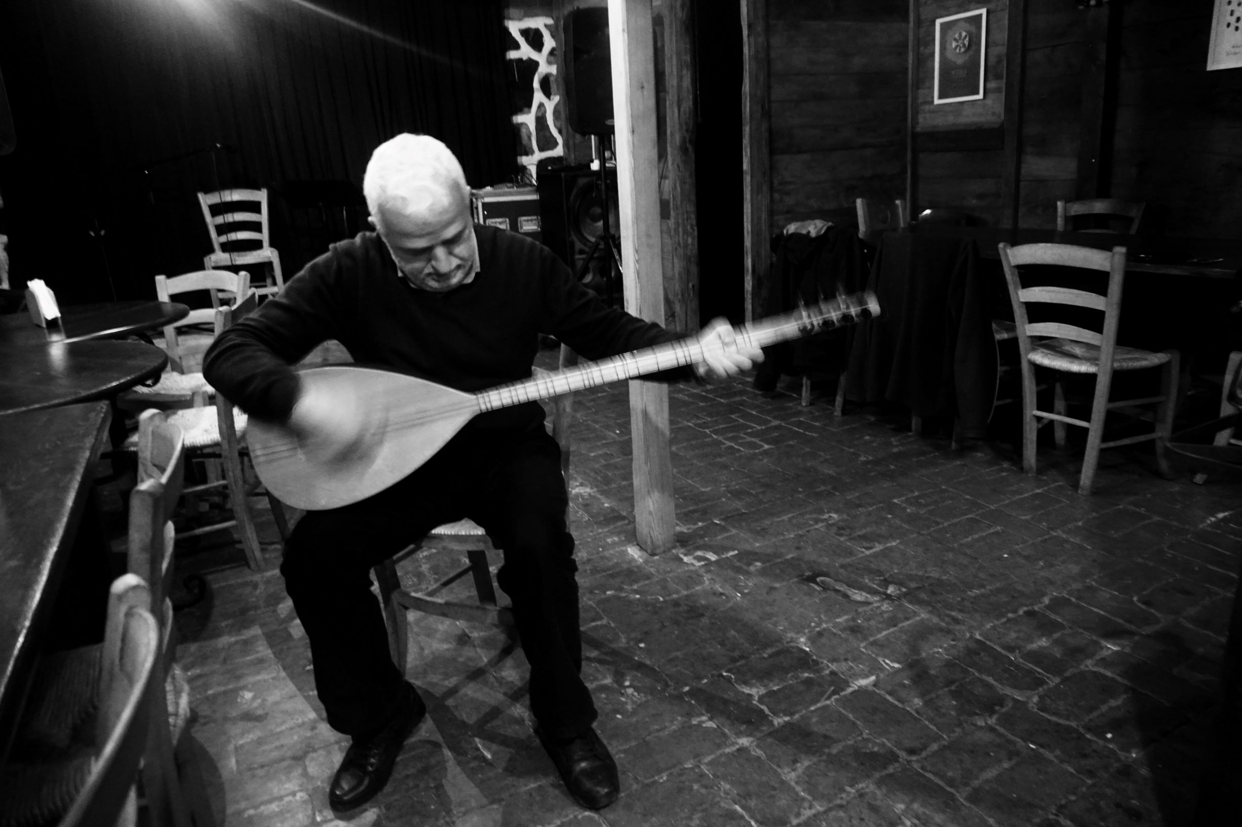 Birol Topaloglu plays a traditional Laz instrument in his guesthouse (Nimet Kirac / MEE)