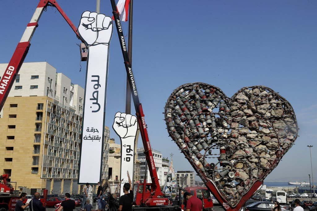 The 'revolution fist', a symbol of Lebanon's uprising, is pictured in Beirut on 22 October (AFP)