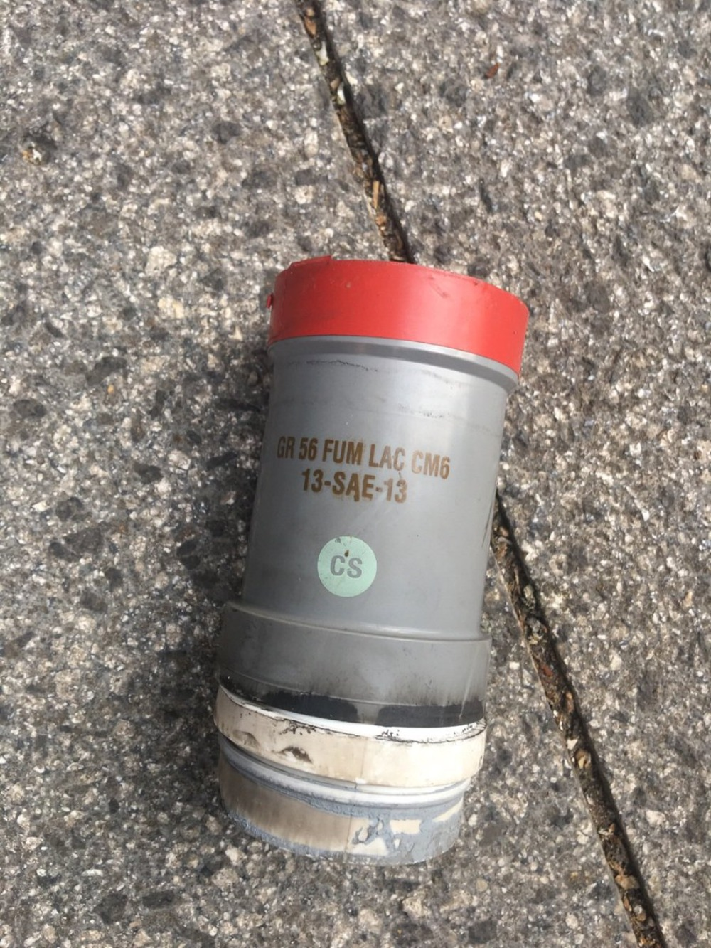 A CM6 tear gas grenade left over after the 18 October incident at Riad al-Solh Square in downtown Beirut (MEE/Kareem Chehayeb)