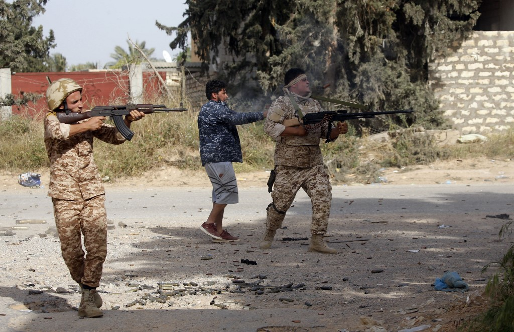 Libyan fighters loyal to the Government of National Accord clash with forces loyal to strongman Khalifa Haftar on 20 April (AFP)