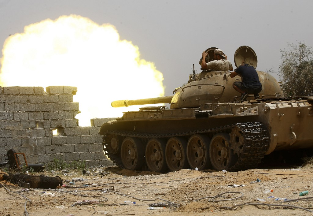 Libyan tanks are fired south of Tripoli on 13 June (AFP)