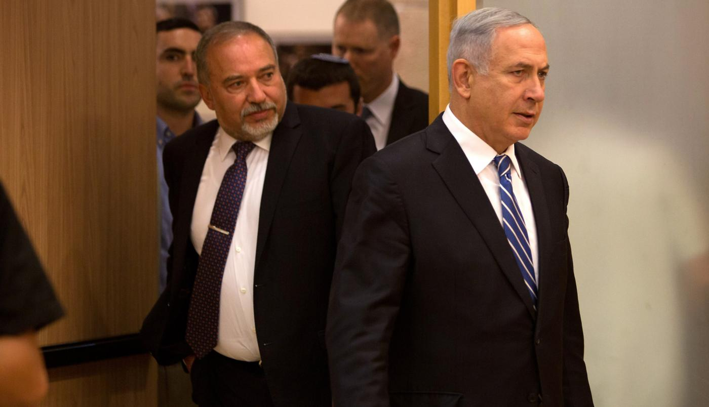 One-time allies Avigdor Lieberman, left, and Benjamin Netanyahu back in 2016 (AFP)