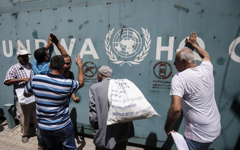 UNRWA employees and their relatives in Gaza City protest against jobs cuts in July (AFP)