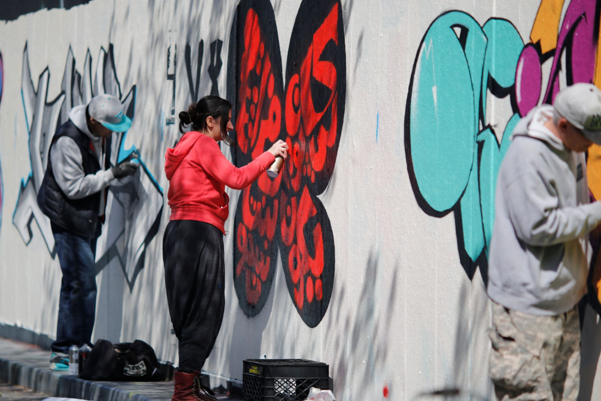 Bahia Shehab sprays a wall with street art in New York (Mark Nikolas)
