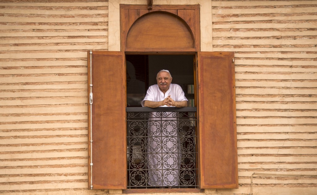 "A Moroccan Jewish man looks out his window at the street below from his house in the ""Mellah"" Jewish quarter of the Medina in Marrakesh, on October 13, 2017."