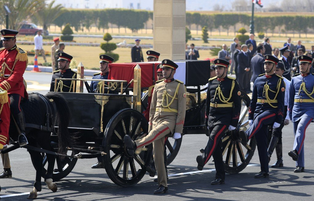 Egyptian honour guards escort Mubarak's coffin during his funeral ceremony in Cairo on 26 February (AFP)