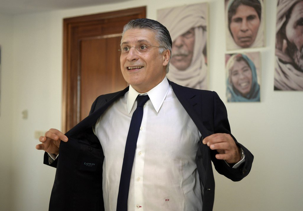 Nabil Karoui is accused of using his charitable foundation and TV station to promote his candidacy (AFP)