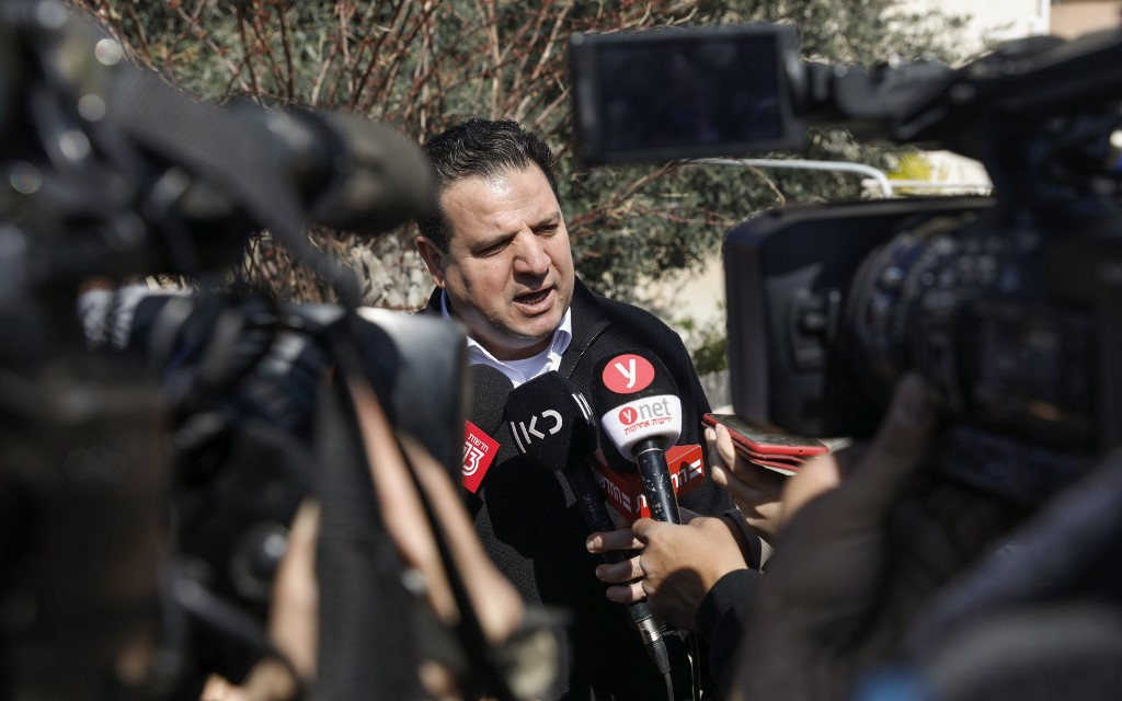Joint List leader Ayman Odeh speaks to reporters in Haifa, Israel, on 3 March (AFP)