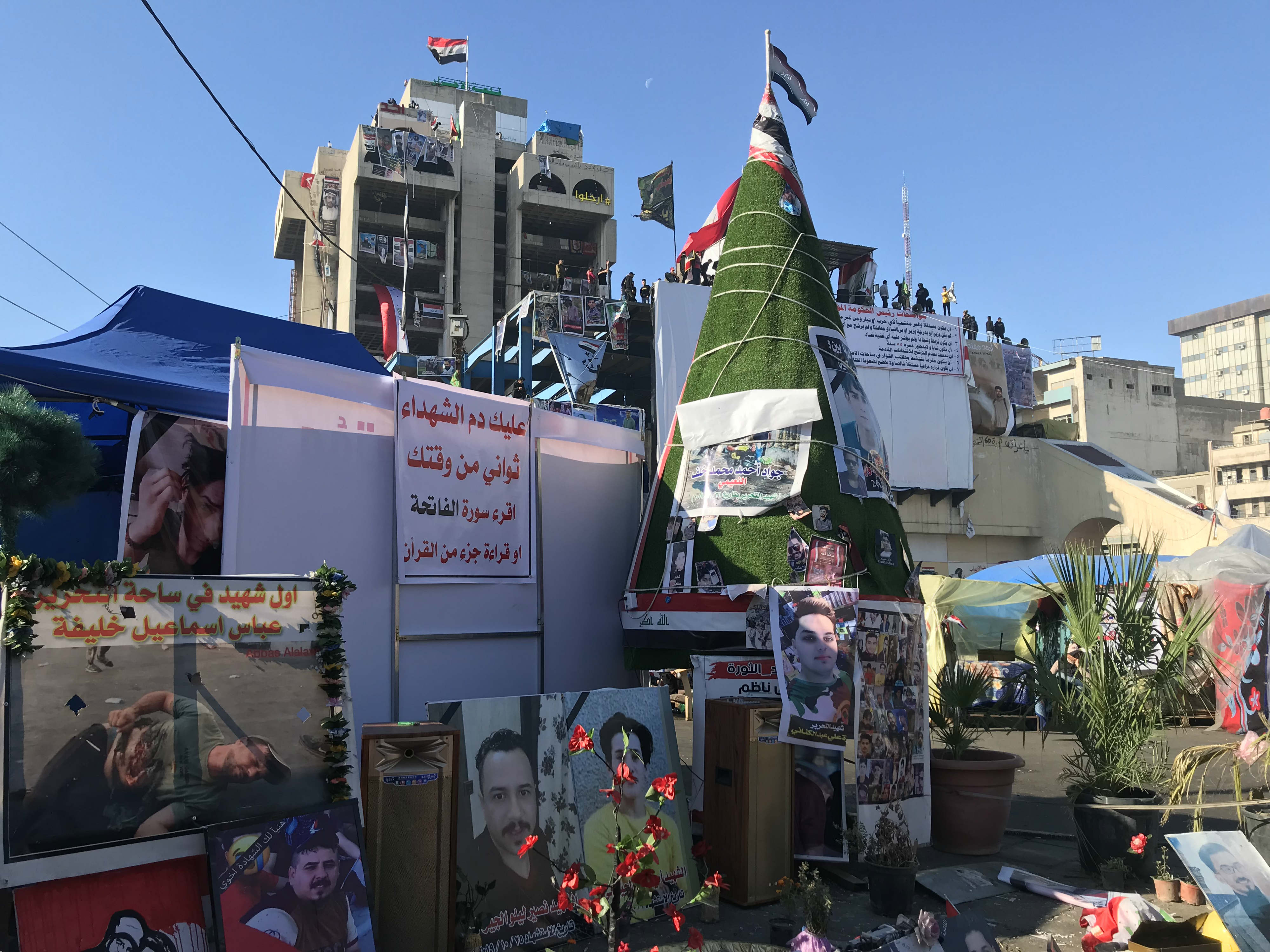 Protesters in Tahrir Square put up pictures of martyrs and decorated them with lights (MEE/Azhar Al-Rubaie)