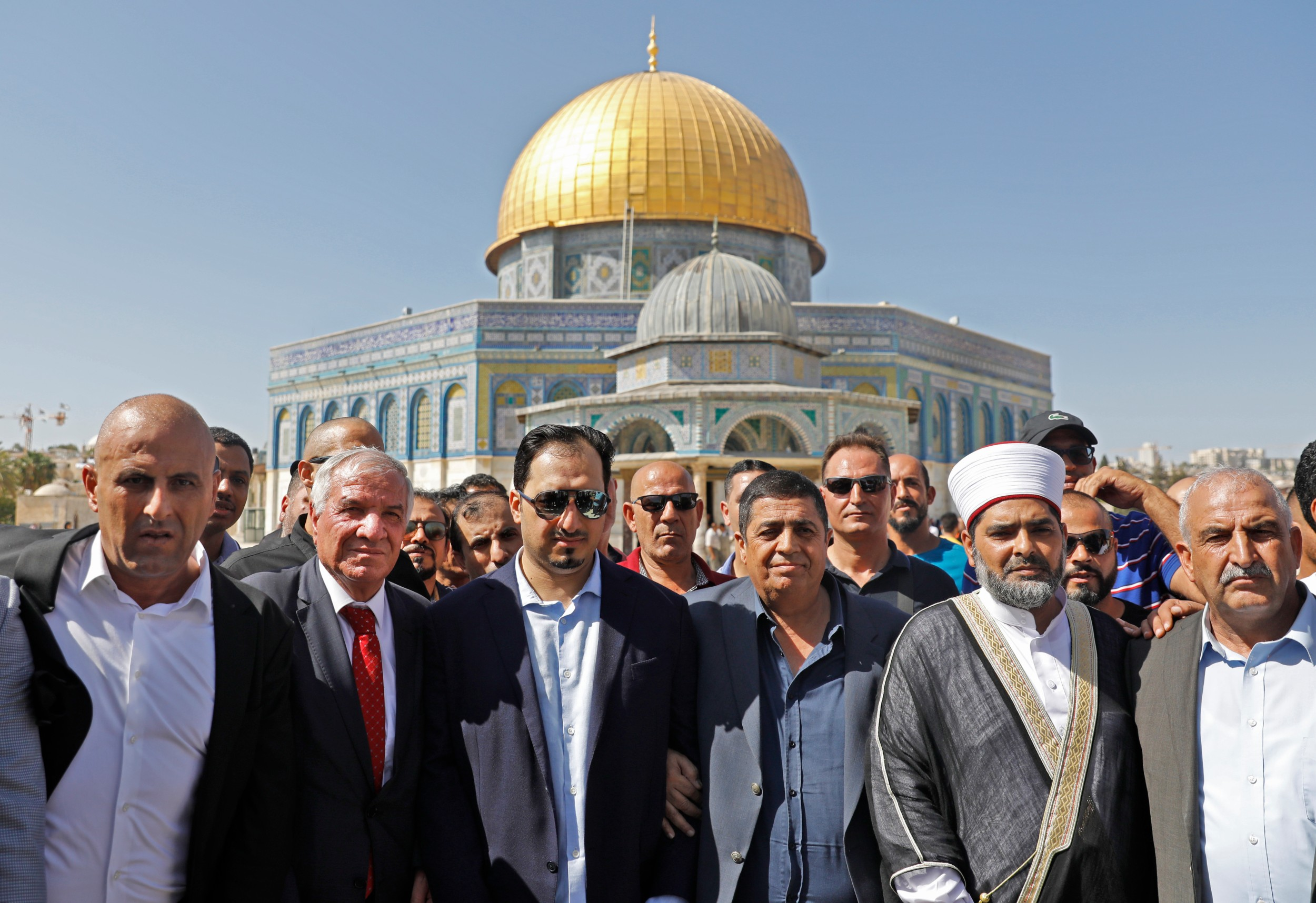 Saudi Football Federation chief Yasser Almisehal, centre, and members of the Saudi football delegation visit the Al-Aqsa Mosque compound in the Old City of Jerusalem on 14 October 2019 (AFP)