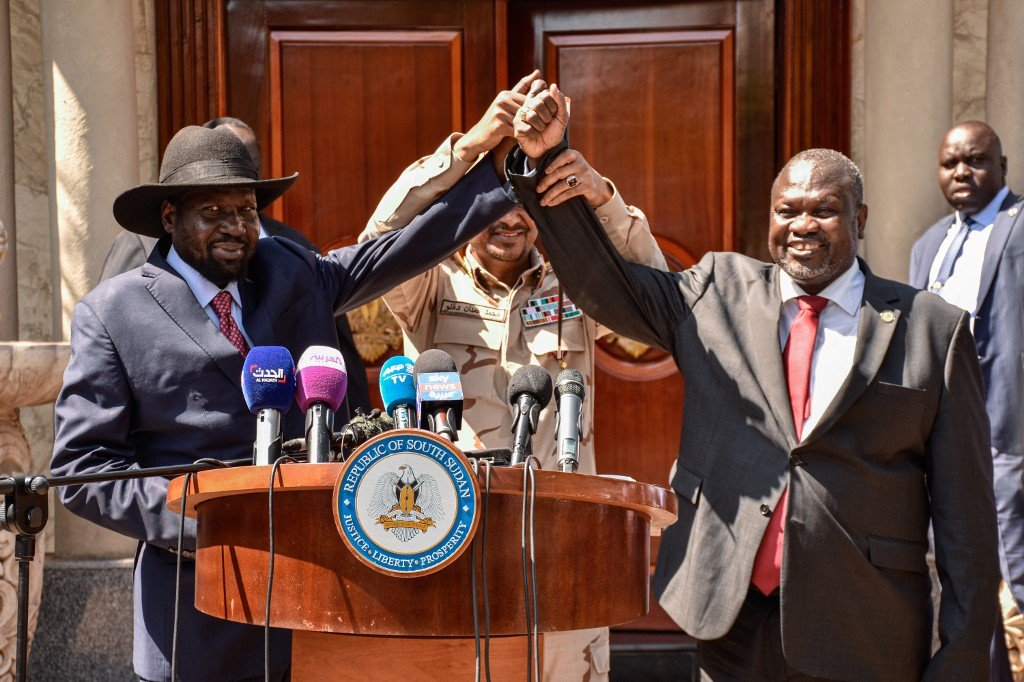 South Sudanese President Salva Kiir, opposition leader Riek Machar and Hemeti speak to the media after peace talks in Juba on 17 December (AFP)