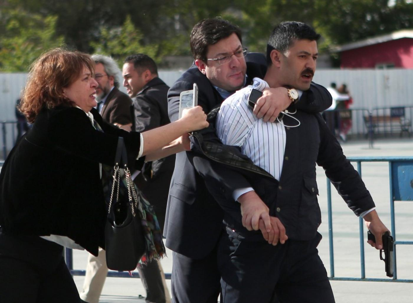 Dilek Dundar, the wife of Cumhuriyet editor in chief Can Dundar, trying to stop a gunman from firing shots outside a courthouse in Istanbul (Cumhuriyet/AFP)