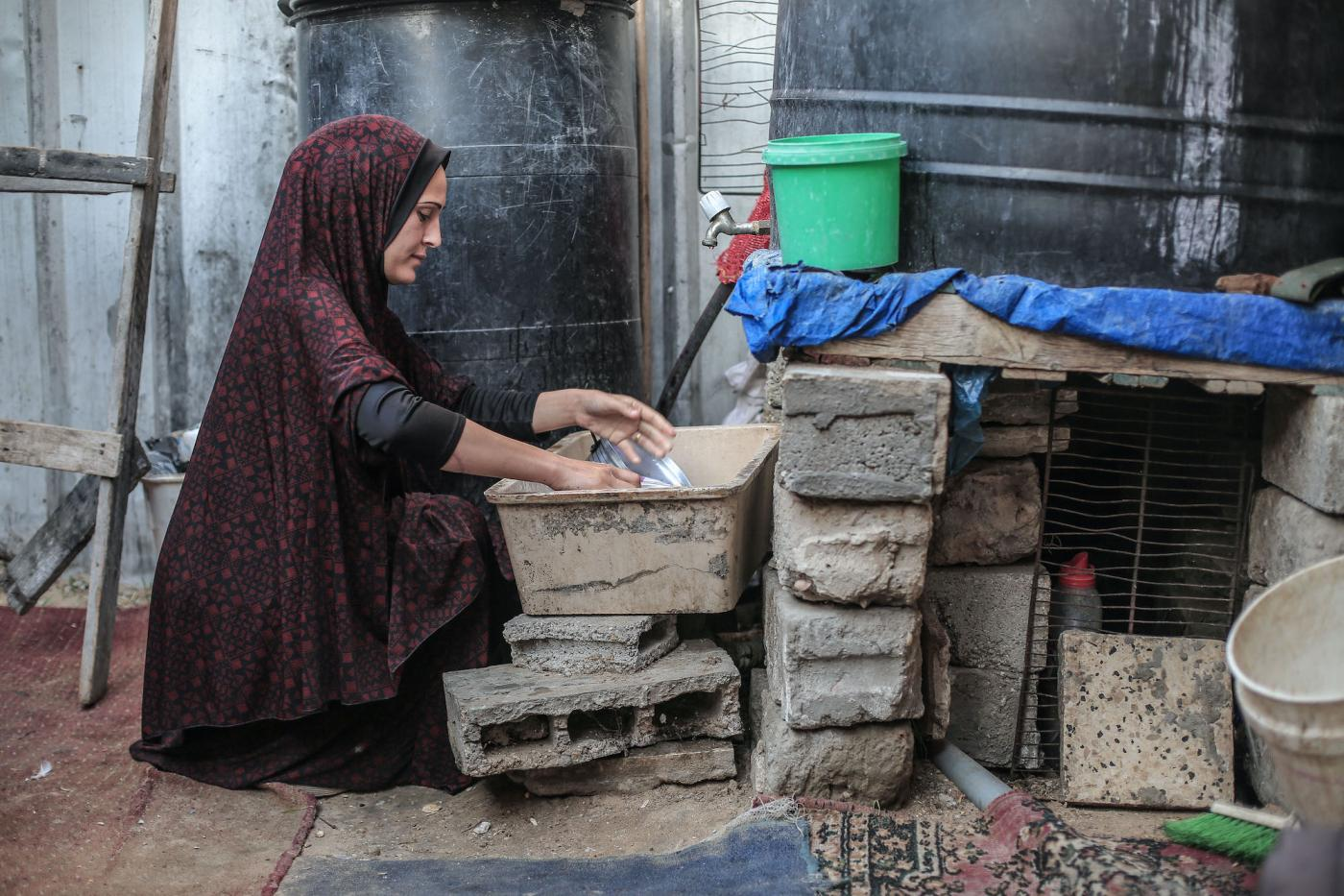 Aisha Abu Nemer says her family struggles to access clean water (Sanad Latefa/MEE)