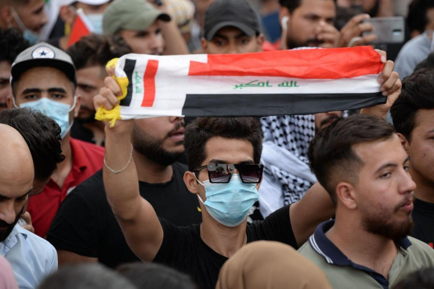 Protesters poured into Tahrir Square to commemorate the first anniversary of Iraq's demonstration.
