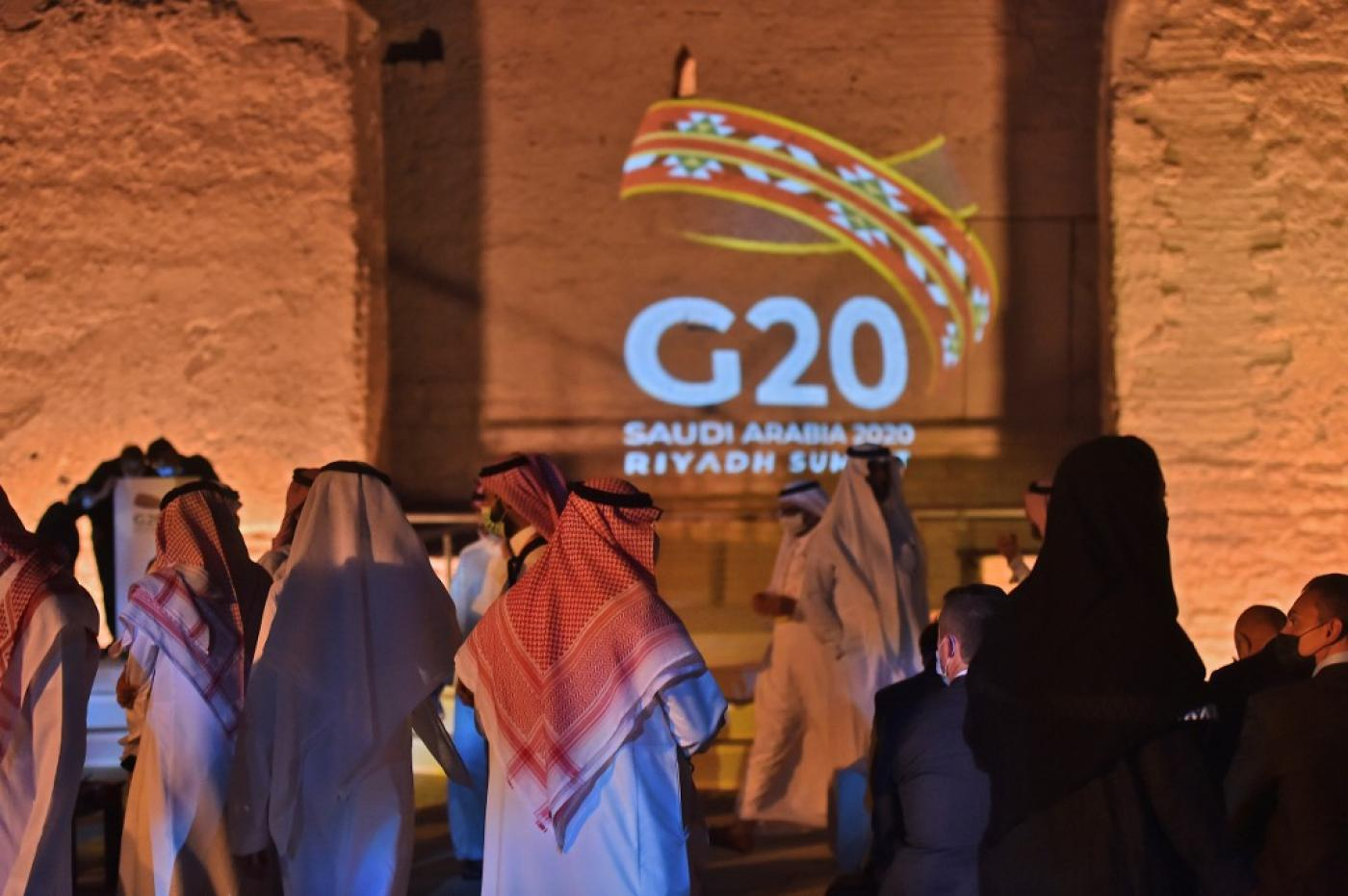 The G20 logo is projected at the historical site of al-Tarif in Diriyah district