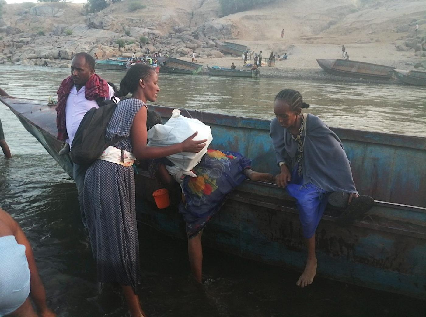 Ethiopian refugees arrive by boat into Sudan