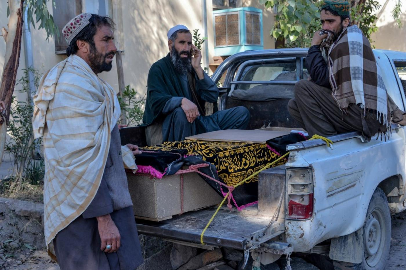 Relatives mourn next to the coffin of a victim who was killed during an air strike in Nangarhar province on 15 February 2020.