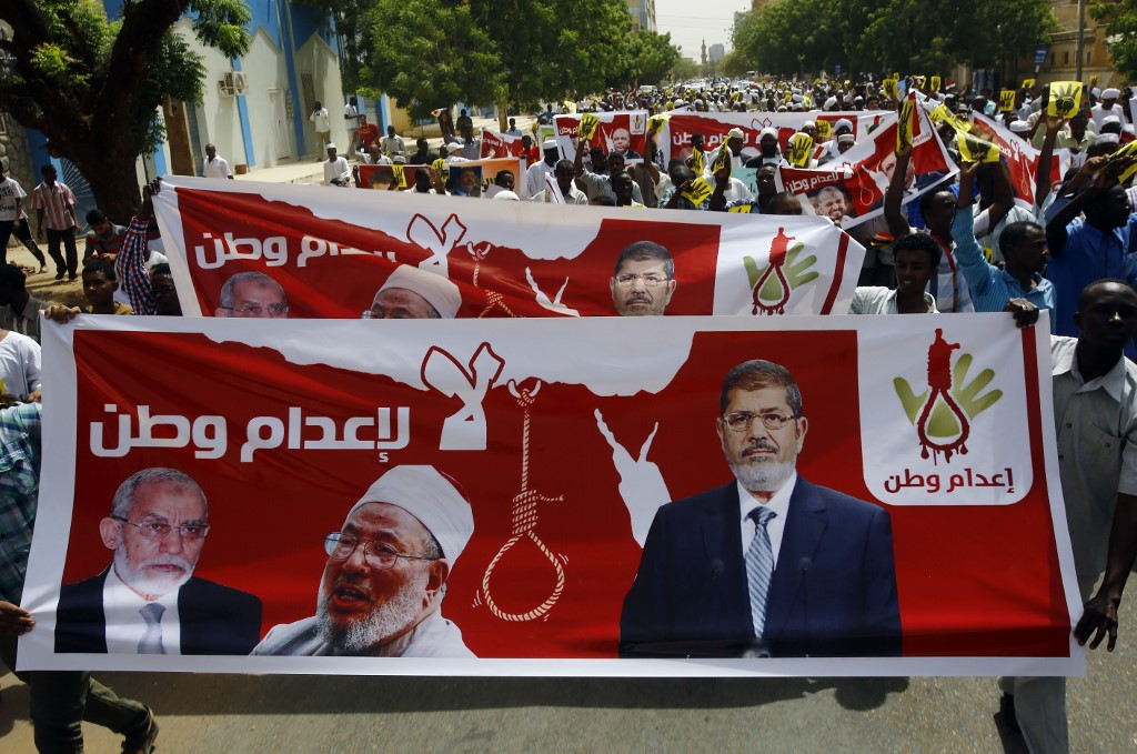 Sudanese Islamists protest the death sentences handed down to former Egyptian President Mohamed Morsi, Badie and other co-defendants in 2015 (AFP)