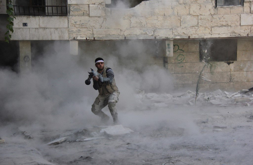 A Syrian opposition fighter fires an RPG during clashes in Aleppo in 2013 (AFP)