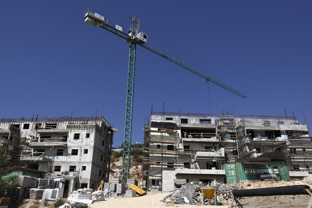 Construction continues at the Israeli Talmon settlement, north of Ramallah, on 31 July (AFP)