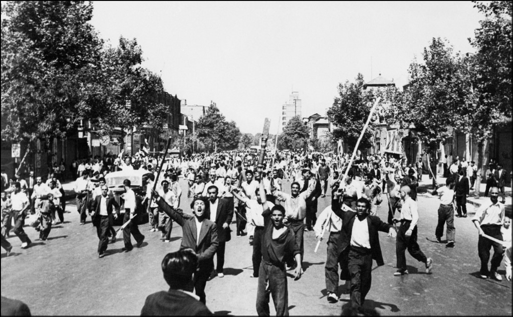 Rioters shout slogans in Tehran after the August 1953 coup (AFP)