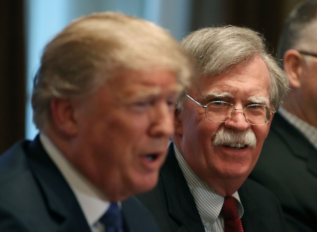 US President Donald Trump and his former national security adviser, John Bolton, are pictured in Washington in April 2018 (AFP)