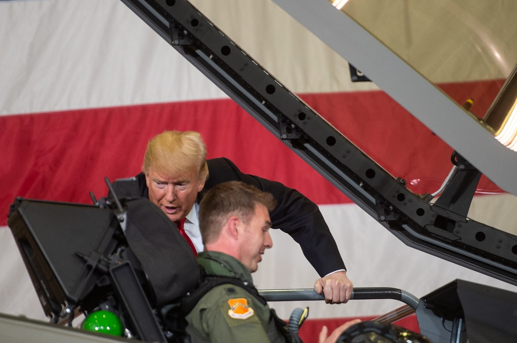 US President Donald Trump speaks with an F-35 pilot in Arizona in 2018 (AFP)