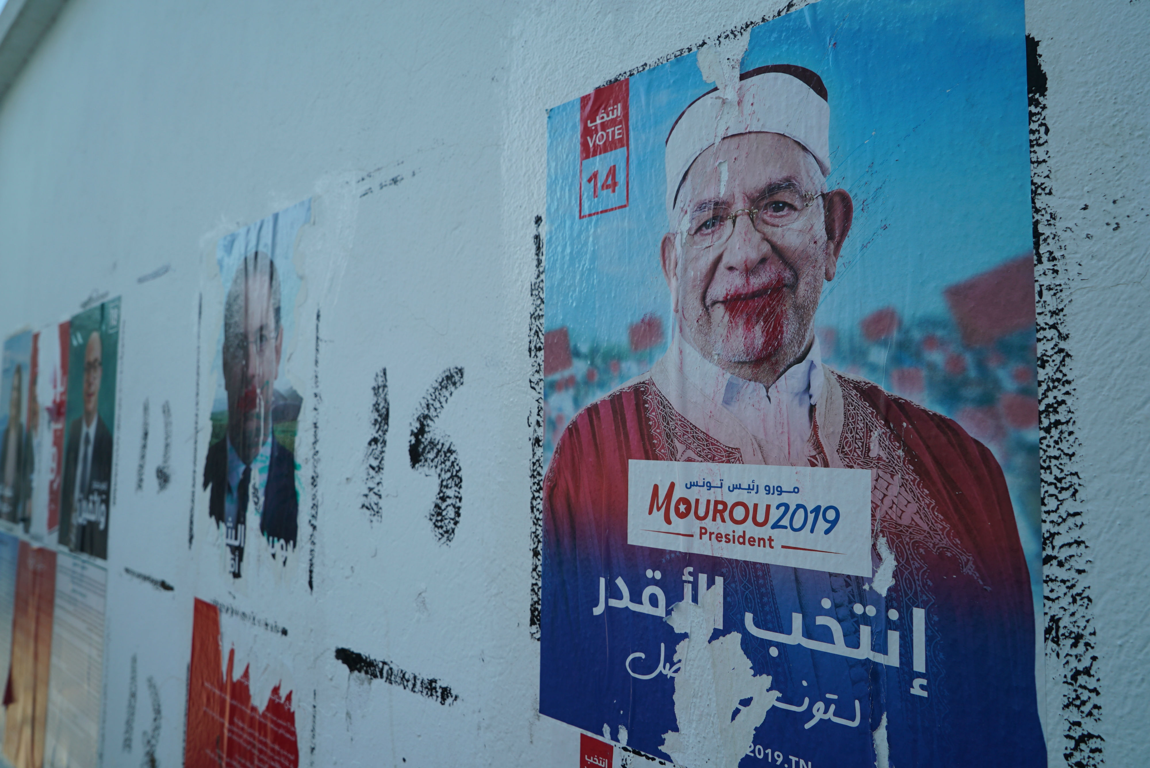 Some posters of the presidential candidates in the capital have been defaced (MEE/Faisal Edroos)