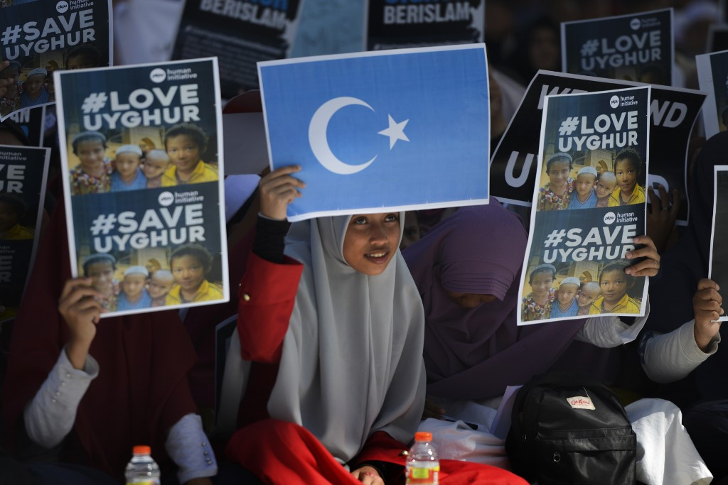 Indonesian Muslims denounce China's policy on Uighurs on 21 December (AFP)