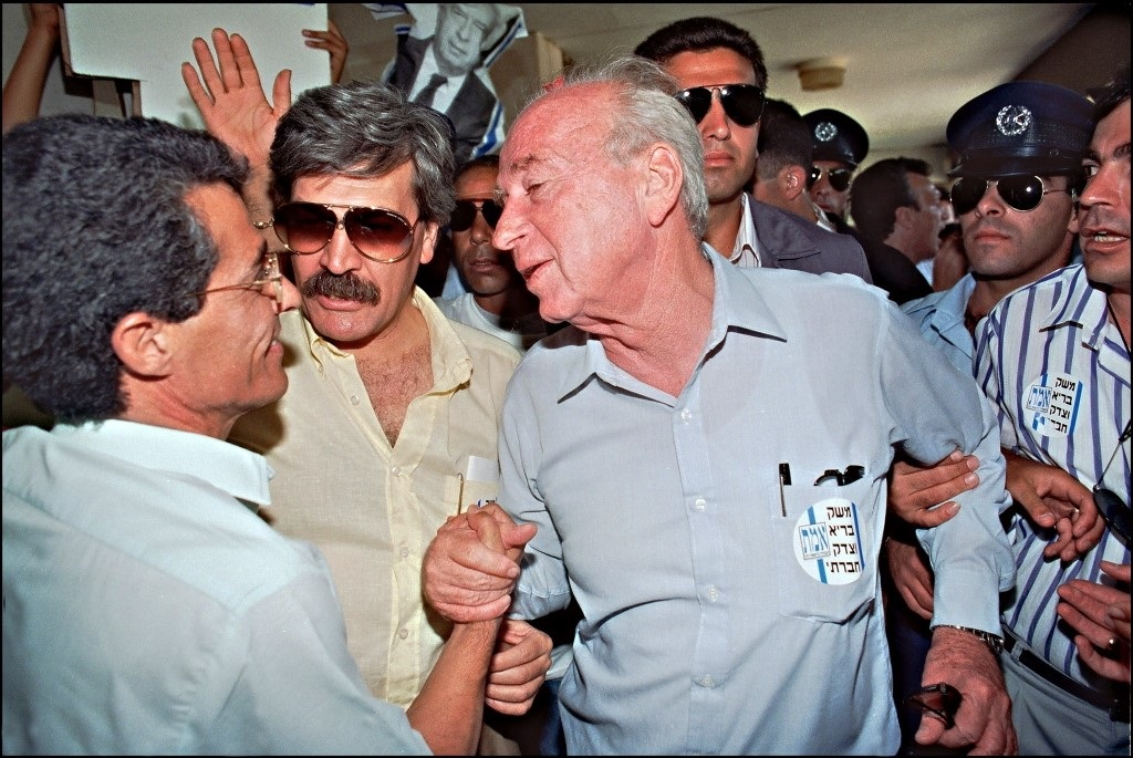 Then Israel's Labor party leader Yitzhak Rabin (c) is greeted by supporters in 1992 during an election campaign stop in a right-wing Likud party stronghold settlement of Maale Adumin (AFP)